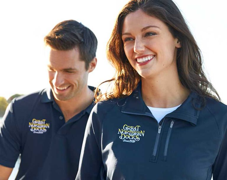 Models wearing lightweight sport shirts with logos